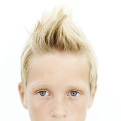 Young Boy (8-10) with His Hair Sticking Up