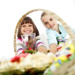 Two Young Girls Sitting with a Basketful of Candy
