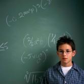 Schoolboy at Chalkboard