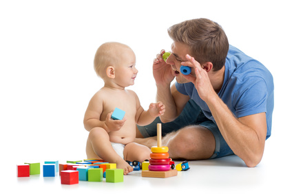 child  boy and father playing together