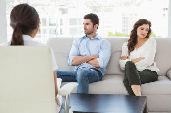 Psychologist helping a couple with relationship difficulties in