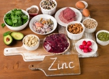 Foods with Zinc mineral on a wooden table.